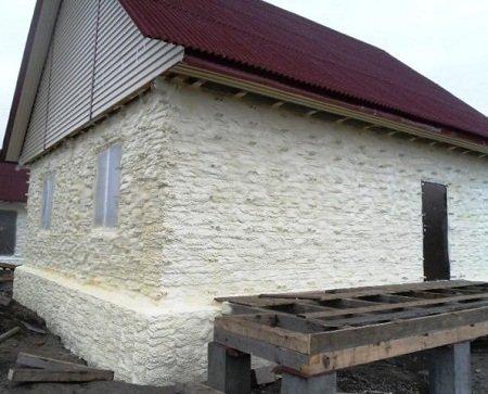 Отделка фасада штукатуркой под камень